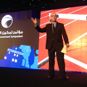Zev Siegl presenting in Kuwait City
